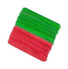 New craft sticks in holiday hues on a white background