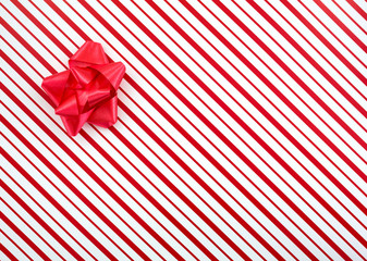 Close view of a Christmas box with a red bow