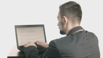 Business man computer programmer typing at his desk