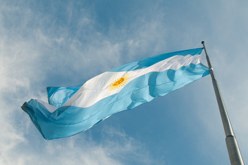 Flag Buenos Aires growing against the blue sky.