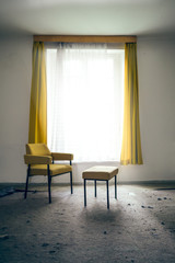 Chair and stool by the window
