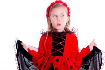 Mädchen beim pfeifen im rot schwarzem Kleid - isoliert