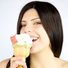 Closeup of woman eating fruit ice-cream