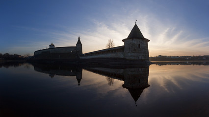 Old Pskov Kremlin on the river in the evening at sunset
