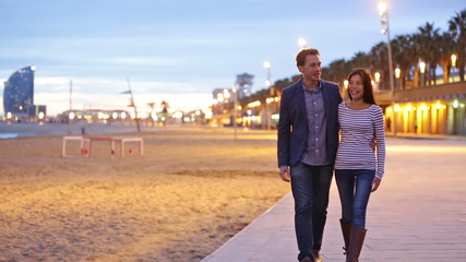 Couple walking at Barcelona Beach, Barceloneta