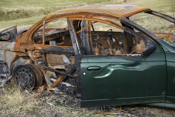 Green car destroyed by fire