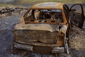 Back of a car that has been through a fire