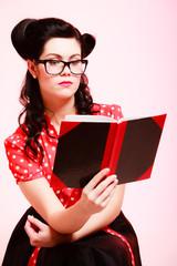Retro. Pinup girl in eyeglasses reading book