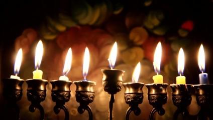 Beautiful lit hanukkah menorah on dark abstract background