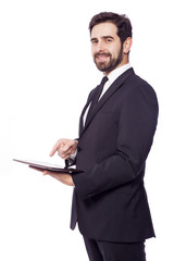 Businessman standing with a tablet computer, isolated on a white