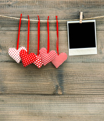 Red hearts and vintage polaroid photo frame. Valentines Day
