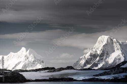 Snow-capped mountains in Antarctica - 76028704