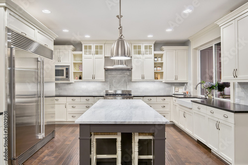 Beautiful Kitchen in Luxury Home with Island and Stainless Steel - 76029308
