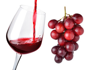glass of wine and grapes isolated on white