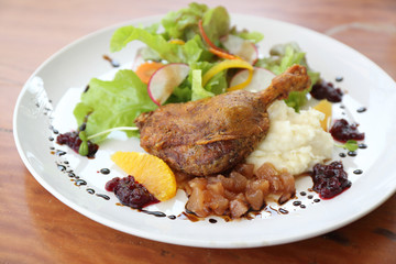 Duck confit , Roasted duck with blueberry sauce
