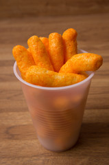 Cheesepuffs in a plastic cup
