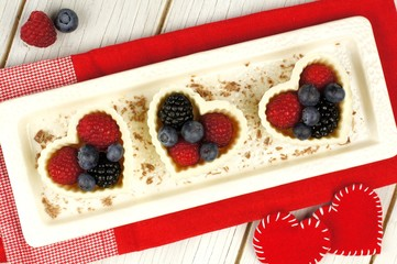 Valentines Day heart shaped white chocolate cups with berries