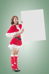 Christmas girl holding a blank board