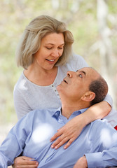 Smiling aged couple hugging each other