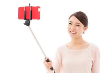 young asian woman taking photo