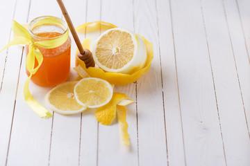Lemons and honey in glass jar