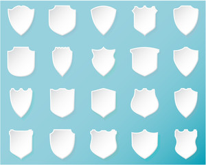 Shiny white shields on  blue background.