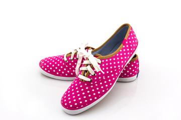 Pink polka dot canvas shoe .