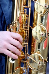 Young's hand playing with sounds experienced saxophone