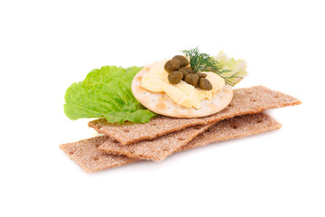 Crackers with fresh vegetables and butter