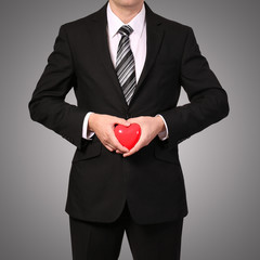Man in suit with red heart. Valentine's Day
