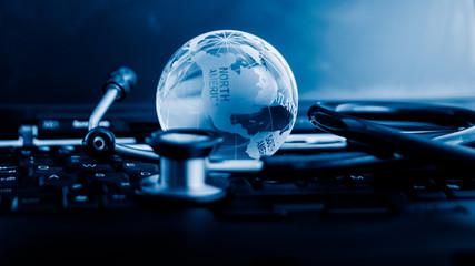 Glass globe and stethoscope