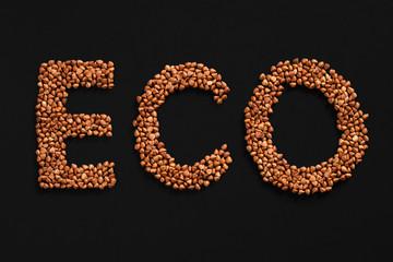 Word Eco composed of premium buckwheat groats on black