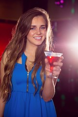 Pretty girl drinking a cocktail