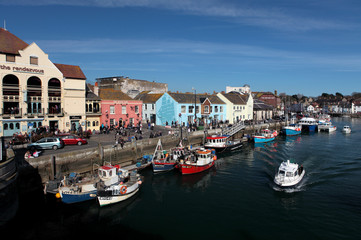 Weymouth harbour on a bright sunny summer day