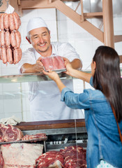 Man Selling Fresh Packed Of Sausages To Customer
