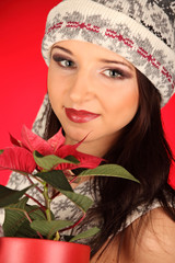 Christmas girl with red flower in her hand