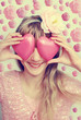 funny girl holding hearts on eyes-vintage style