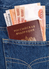 Russian rouble bills, train tickets  and passport in the back je