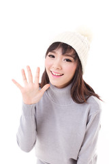 happy, smiling, joyful woman wearing knit hat, showing her palm