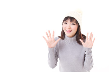 happy, smiling, joyful woman wearing knit hat, showing her palm