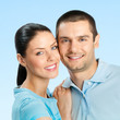 Cheerful young couple, over blue