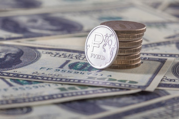New russian ruble coin and american dollars