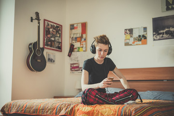young lesbian stylish hair style woman listening to music
