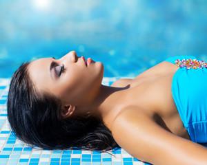 Beautiful woman in an outdoor pool. Spa portrait.