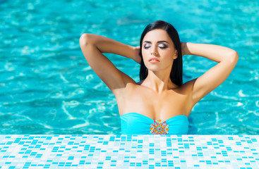 Beautiful woman in an outdoor pool. Spa portrait.