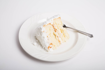 Slice of Coconut Cake on White Counter