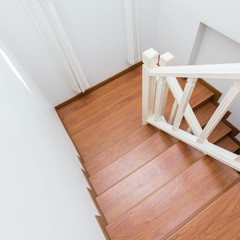 wooden staircase made from laminate wood in white modern house