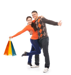 A couple of young and happy persons with shopping bags