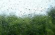 Leinwandbild Motiv Regentropfen auf Autoscheibe