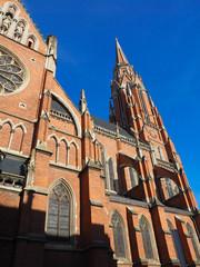red brick church and blue sky in Osijek Croatia